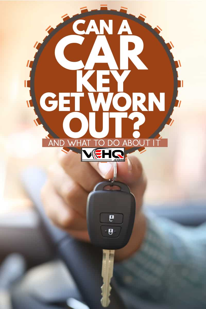 A man holding the car keys of his convertible car, Can A Car Key Get Worn Out? (And What To Do About It)