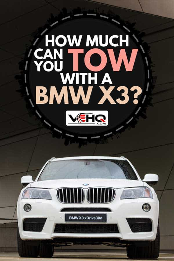 White BMW X3 powerful SUV car parked against modern building, How Much Can You Tow With A BMW X3?
