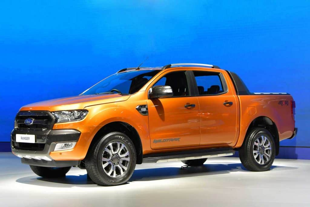 Orange Ford Ranger pickup truck on display at a motor show, Pickup Truck Door Won't Open? Here's What To Do
