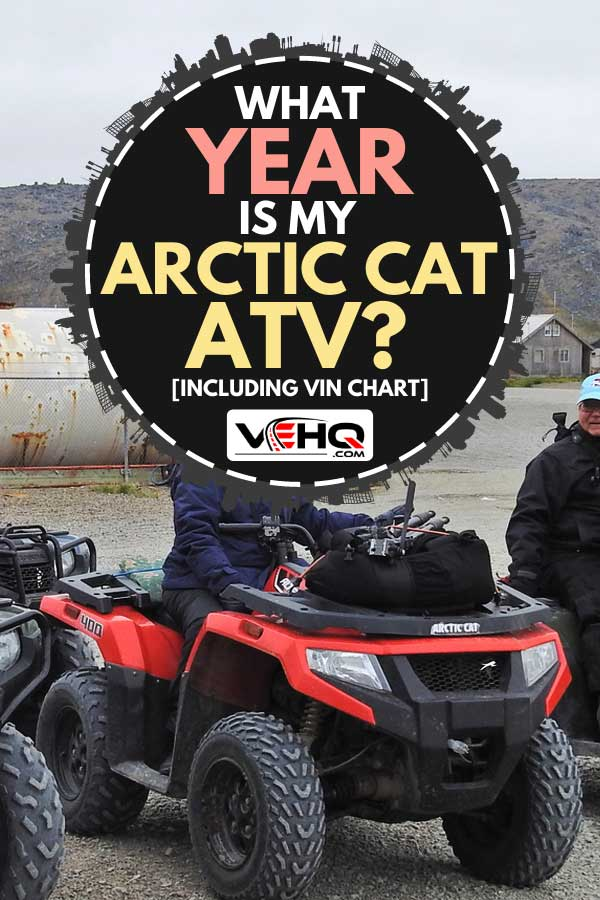 Person riding a Red Arctic Cat ATV in a field, What Year Is My Arctic Cat ATV? [Inc. VIN chart]