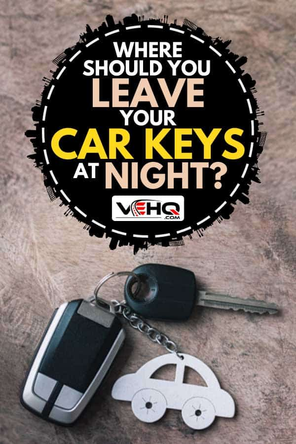 Car key and remote with car keychain on a wooden table, Where Should You Leave Your Car Keys At Night?