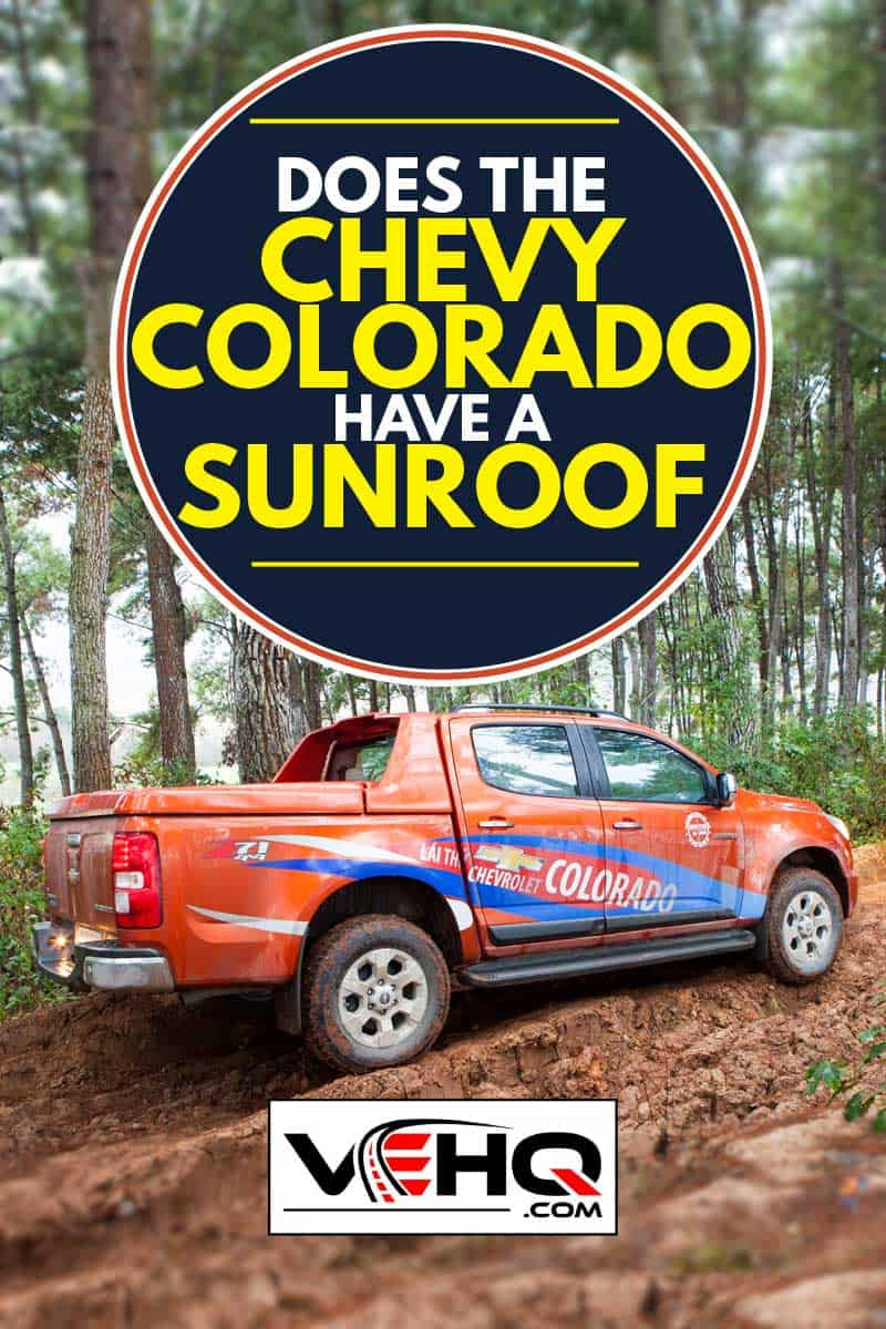 orange Chevy Colorado on a dirt road in the woods, Does the Chevy Colorado Have a Sunroof