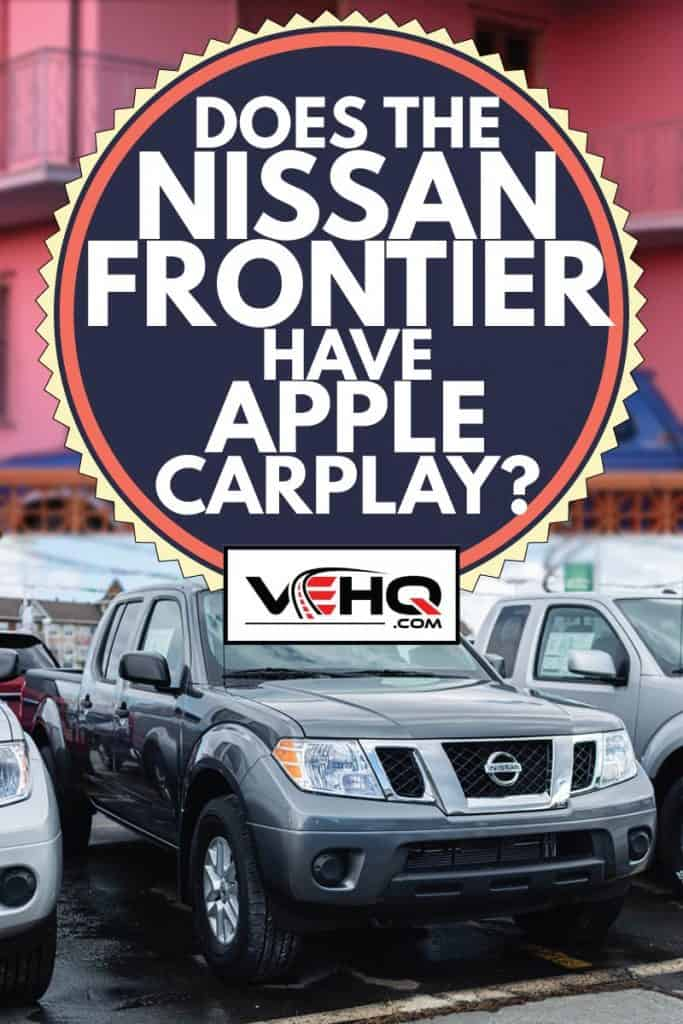 silver nissan frontier parked in a dealership, does the nissan frontier have apple car play