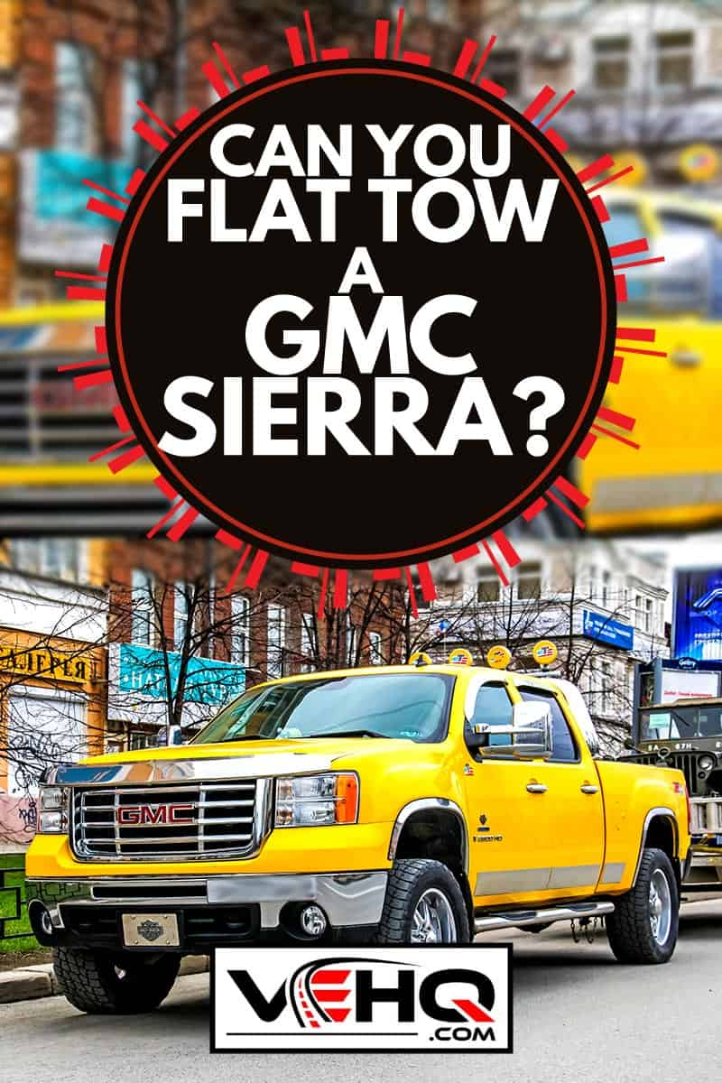 A yellow GMC Sierra parked on the side of the road, Can you flat tow a GMC Sierra?