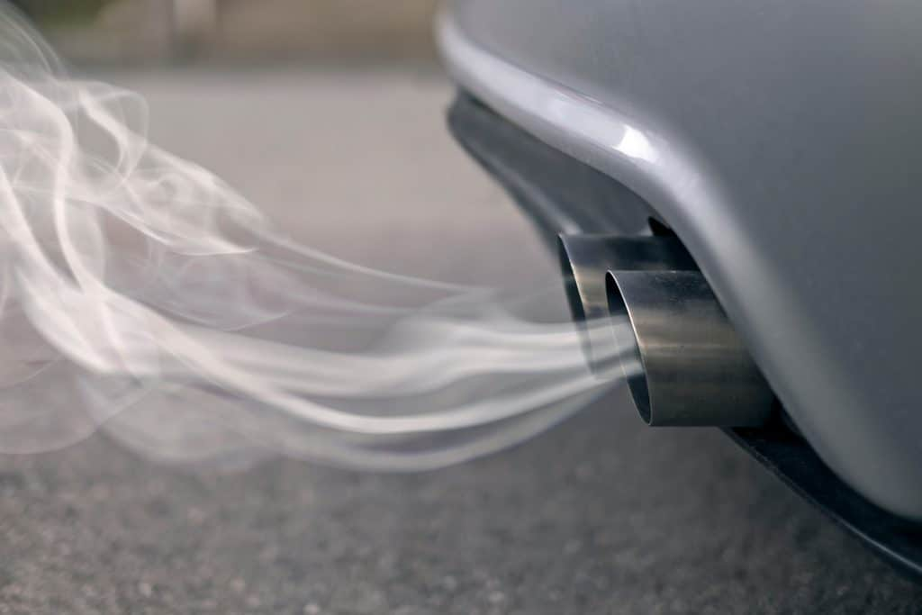 A car exhaust with smoke coming out