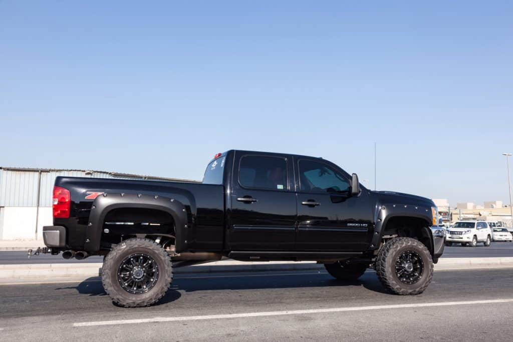 Huge Chevy Silverado uplifted with huge tires cruising down the road, Chevrolet Silverado Gauges Not Working - What Could Be Wrong?