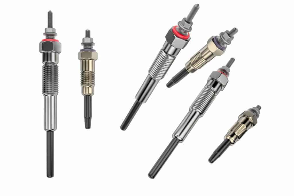 Different kinds of spark plugs on a white background