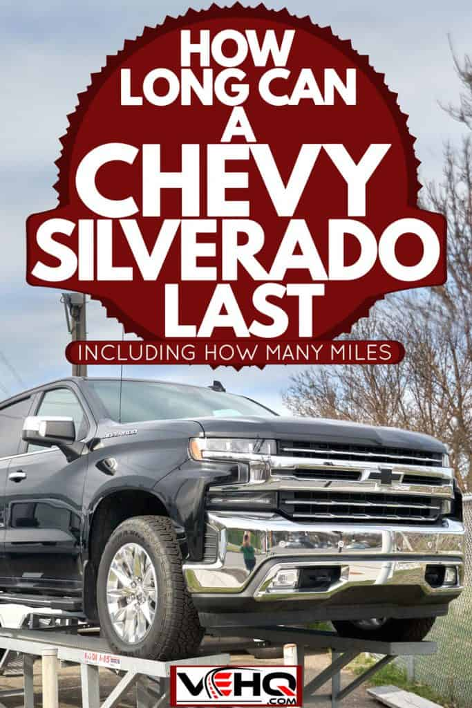 A huge gray Chevrolet Silverado parked on a metal framed parking space, How Long Can A Chevy Silverado Last [Incld. How Many Miles]