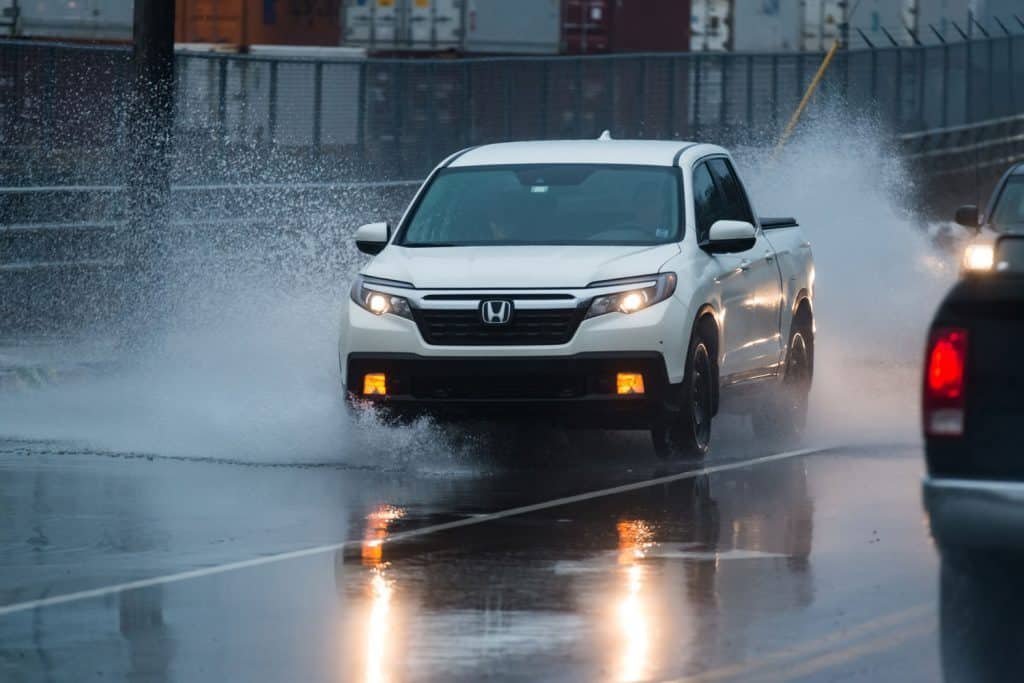 Honda Ridgeline moving on a wet and slippery stretch of highway, Can A Honda Ridgeline Be Flat Towed?