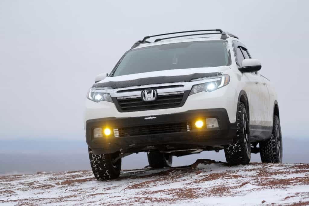 A Honda Ridgeline pickup atop Coyote Butte on a snowy winter day