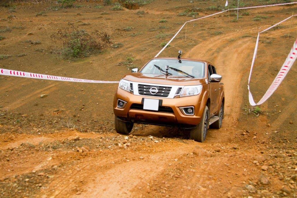 A Nissan Frontier doing a steep crossing test on a company owned test track