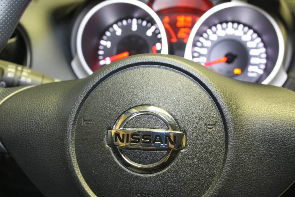 Nissan Titan steering wheel with the odometer and speedometer on the background, Nissan Titan Not Starting - What Could Be Wrong?