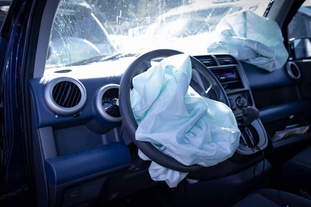 Car accident resulting to car airbags being deployed and a severely broken windshield