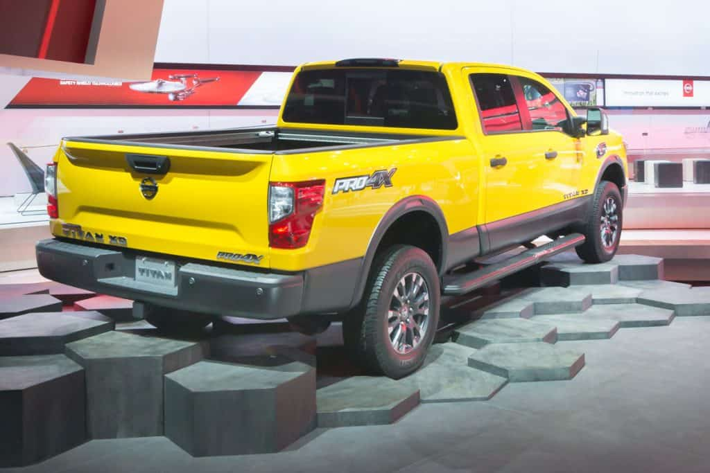 Huge yellow Nissan Titan placed on an artificial octagon shaped terrain at a car show, Does Nissan Titan Have A Diesel Engine?