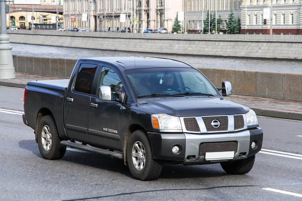 An old Nissan Titan V8 moving on the road