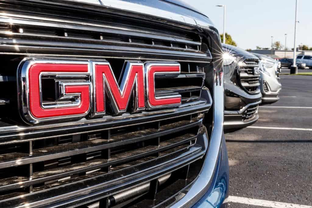 An up close photo of the GMC logo of a GMC Sierra truck