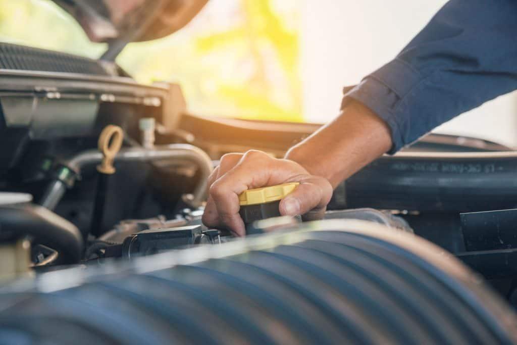 Automobile mechanic hands car repairs automotive technician workshop center