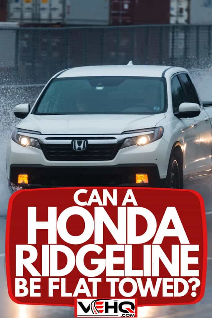 A Honda Ridgeline moving on a wet and slippery stretch of highway, Can A Honda Ridgeline Be Flat Towed?