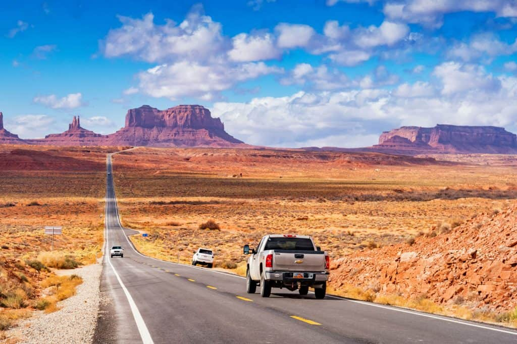 Chevrolet Silverado pick up truck drive at Forrest Gump Point in Monument Valley, Utah, USA