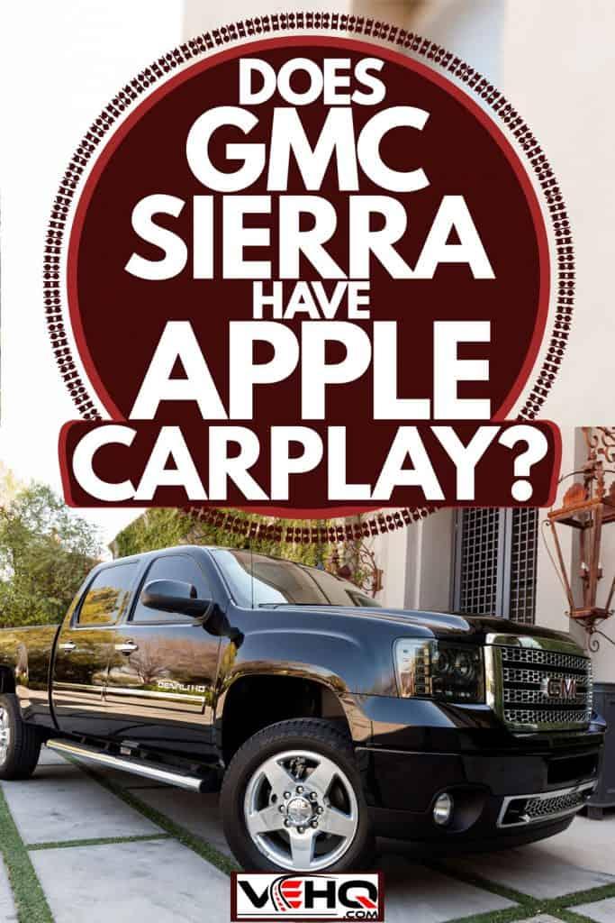 A huge black colored GMC Sierra parked outside a huge house, Does GMC Sierra Have Apple CarPlay?
