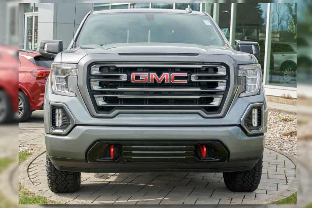 A GMC Canyon parked outside a car dealership
