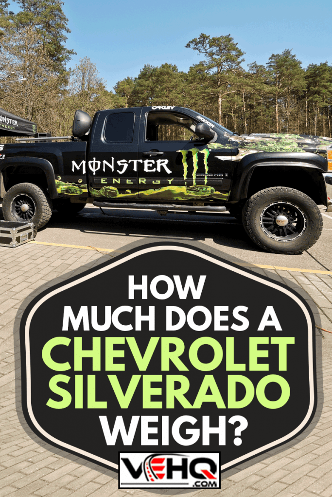 Monster Energy truck Chevrolet Silverado Z71 all covered with Monster Energy stickers parked at parking lot near Monster Energy tent , How Much Does A Chevrolet Silverado Weigh?