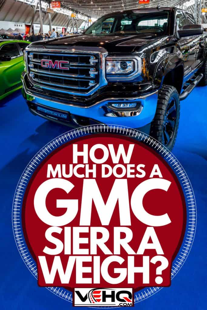 A GMC Sierra parked on a car show with blue tarp flooring, How Much Does A GMC Sierra Weigh?