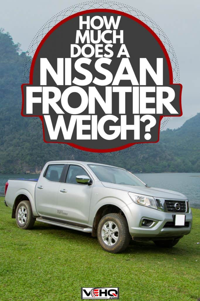 A gray Nissan Frontier parked near the side of a lake, How Much Does A Nissan Frontier Weigh?