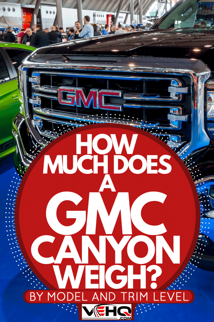 A GMC Canyon displayed on a themed car show, How Much Does a GMC Canyon Weigh? [By Model and Trim Level]