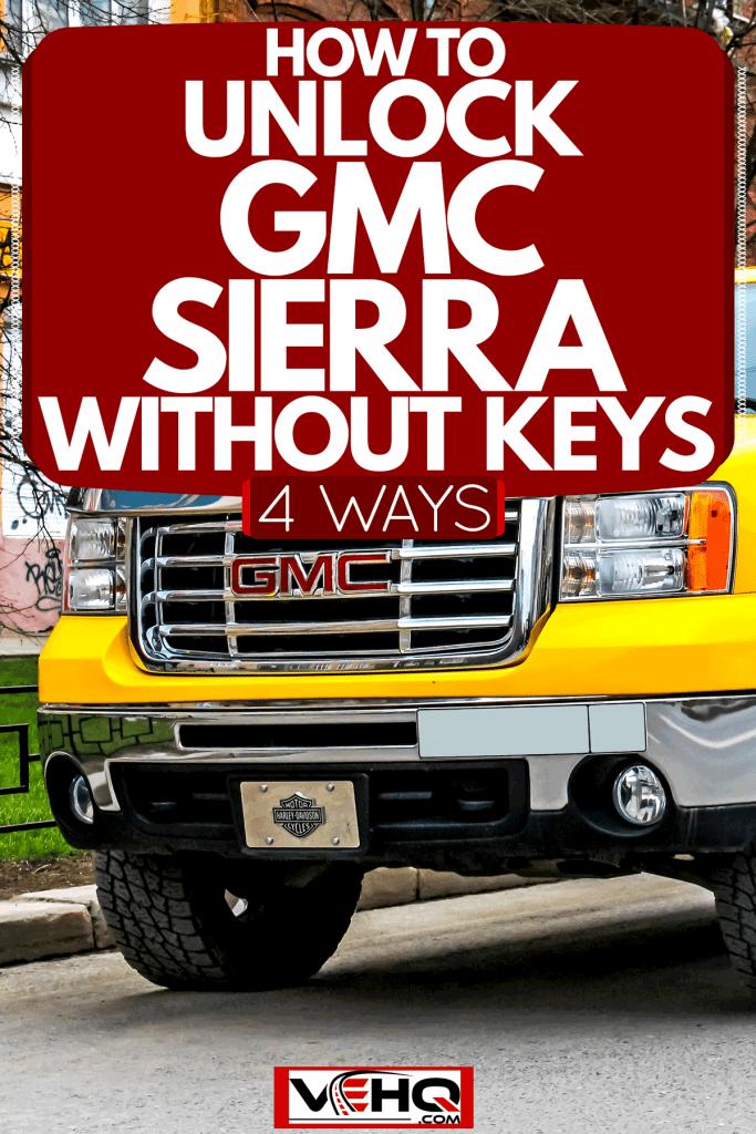 A 2005 HD GMC Sierra parked outside a parking lot, How To Unlock GMC Sierra Without Keys [4 Ways]