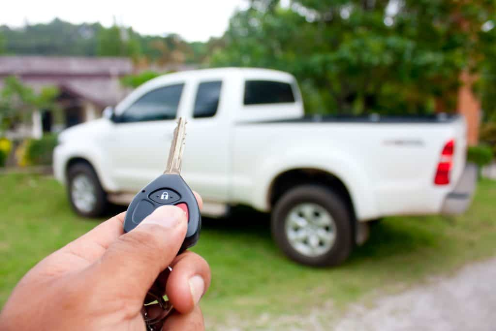 Man pressing lock button of his pickup truck