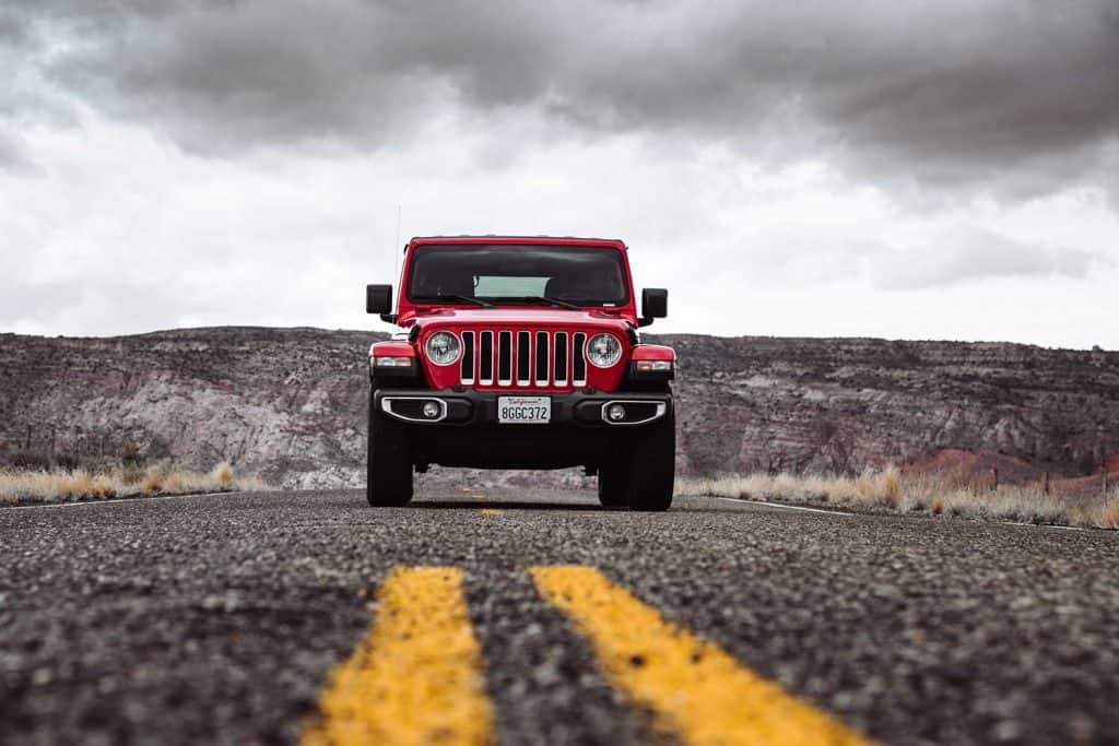 New 2019 Jeep Wrangler parked in the centre of the road on a cloudy day