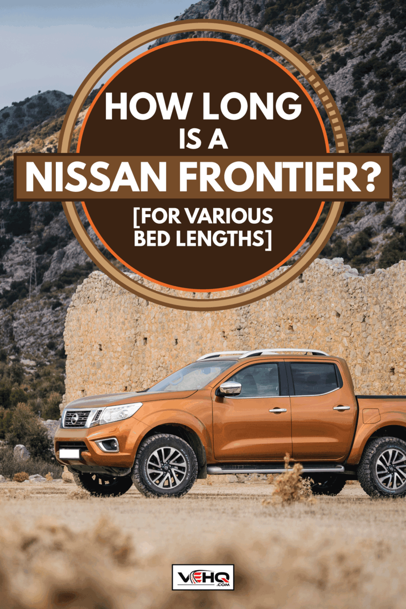 Nissan Frontier NP300 parked at roadside in country road, How Long Is A Nissan Frontier? (For Various Bed Lengths)