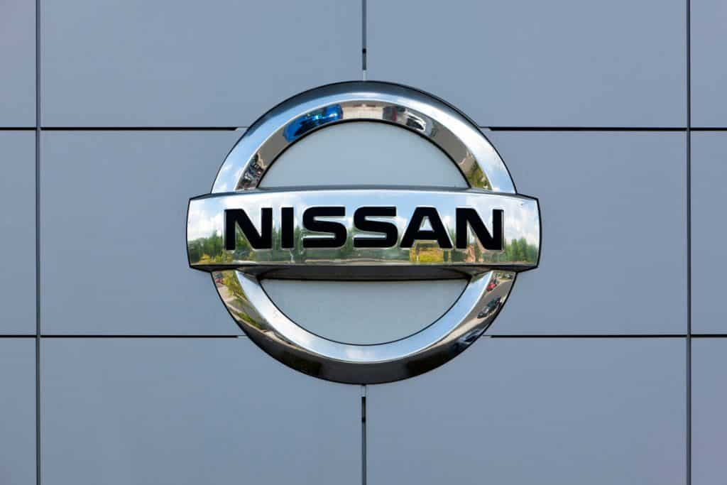 Nissan logo made from stainless steel, How Much Does a Nissan Titan Weigh?