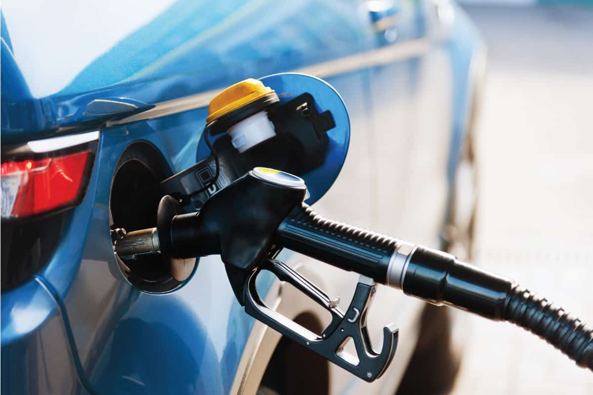 Blue car getting fuel from a diesel pump, What Happens If You Put Diesel In Your Gasoline Car?