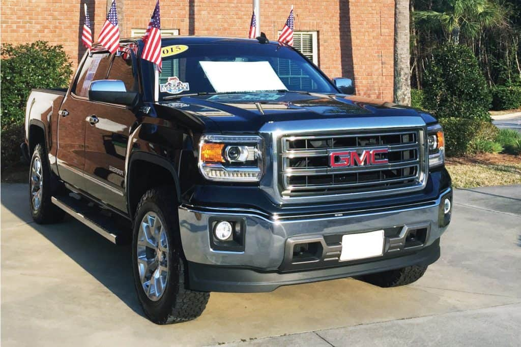 Brand new GMC pickup truck with an American flag, How Many Miles Can A GMC Canyon Last?