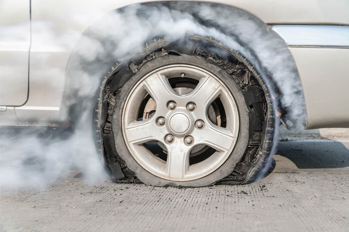 Burst tire on the road attached to a Nissan Frontier