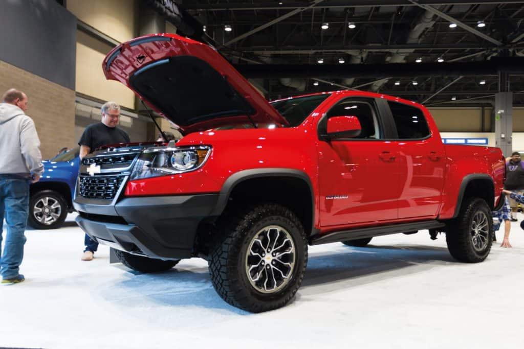Red Chevrolet Colorado in a car show inspected by clients, Can The Chevy Colorado Be Flat Towed?
