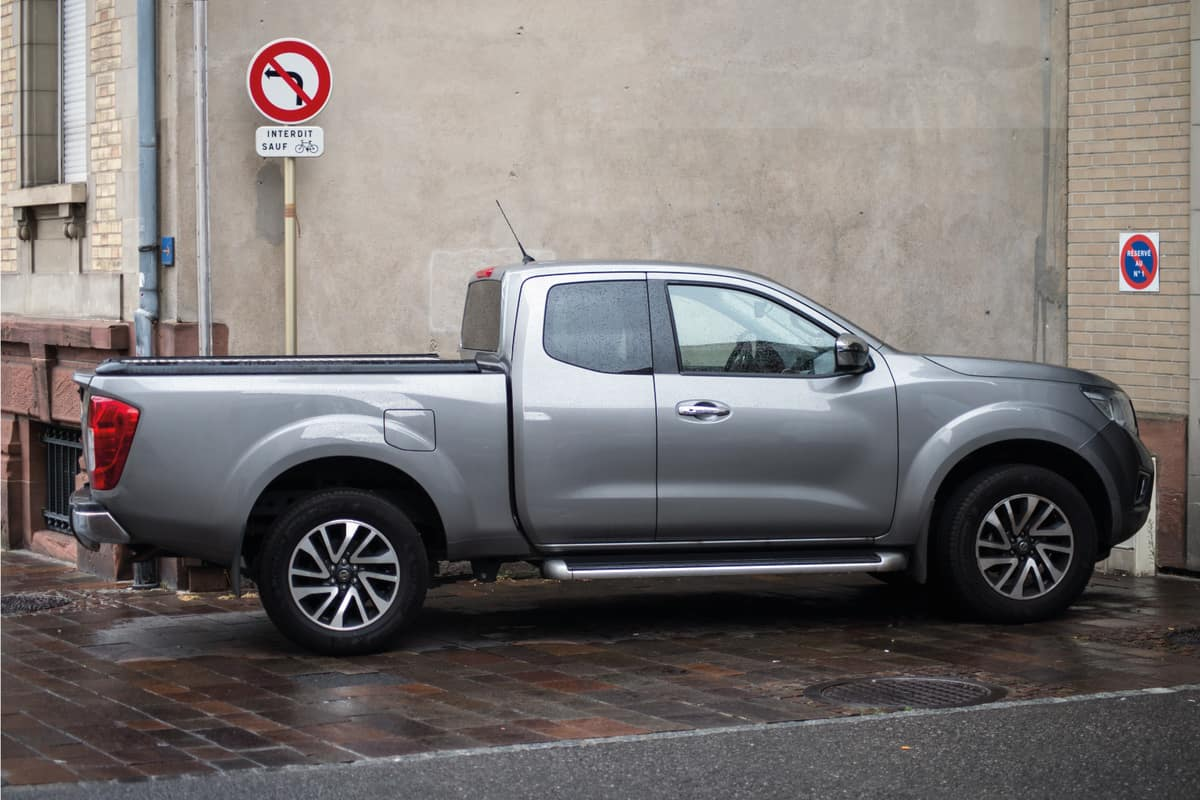 silver gray nissan frontier parked on the side of the street