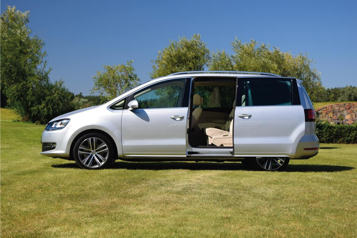 Sliding door on a Volkswagen Sharan stopped on the grass during the press launch