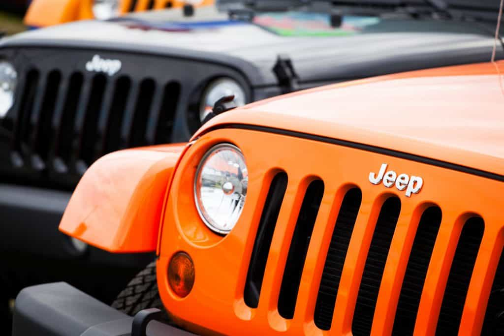 Front fascia of two new Jeeps at a car dealership
