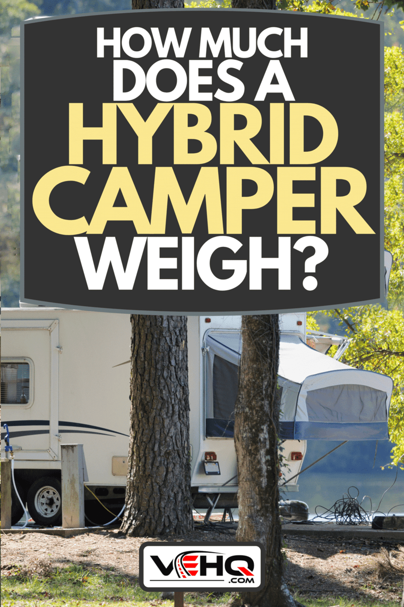 A hybrid camper trailer in campground during autumn, How Much Does A Hybrid Camper Weigh?