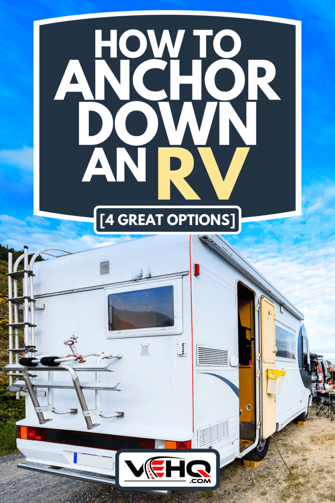 A motorhome RV and campervan are parked on a beach, How To Anchor Down An RV [4 Great Options]