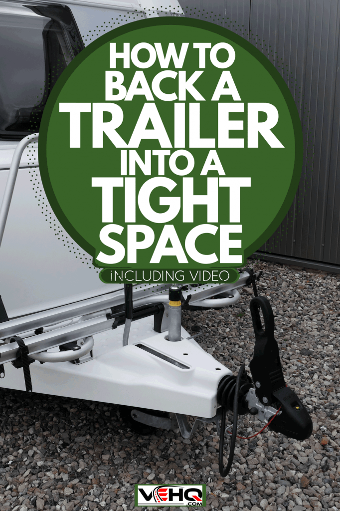 A small trailer parked on a street showing its towing bar, How To Back A Trailer Into A Tight Space [Inc. video]