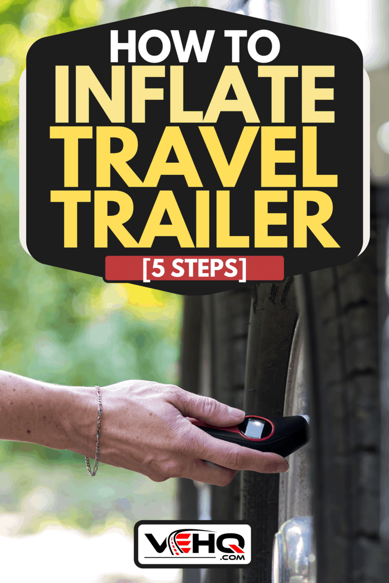 Woman is verifying the tire pressure of her camper trailer before leaving campground, How To Inflate Travel Trailer Tires? [5 Steps]