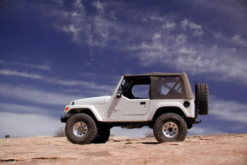 Jeep off road vehicle at the edge of a red rock cliff, What Coolant To Use For Jeep (By Jeep Model)?