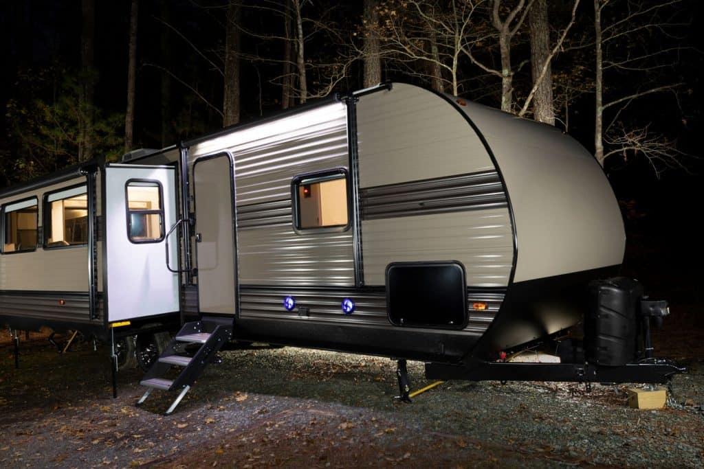Long trailer at a campsite at Jordan Lake in late autumn