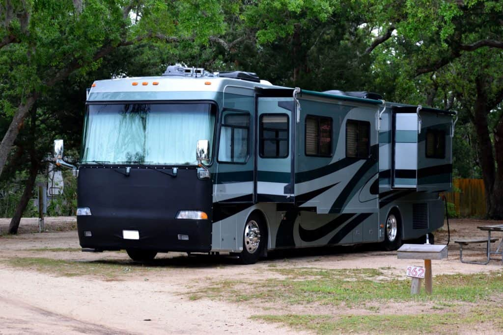 Luxury motor home parked at camp ground site North Beach, Florida