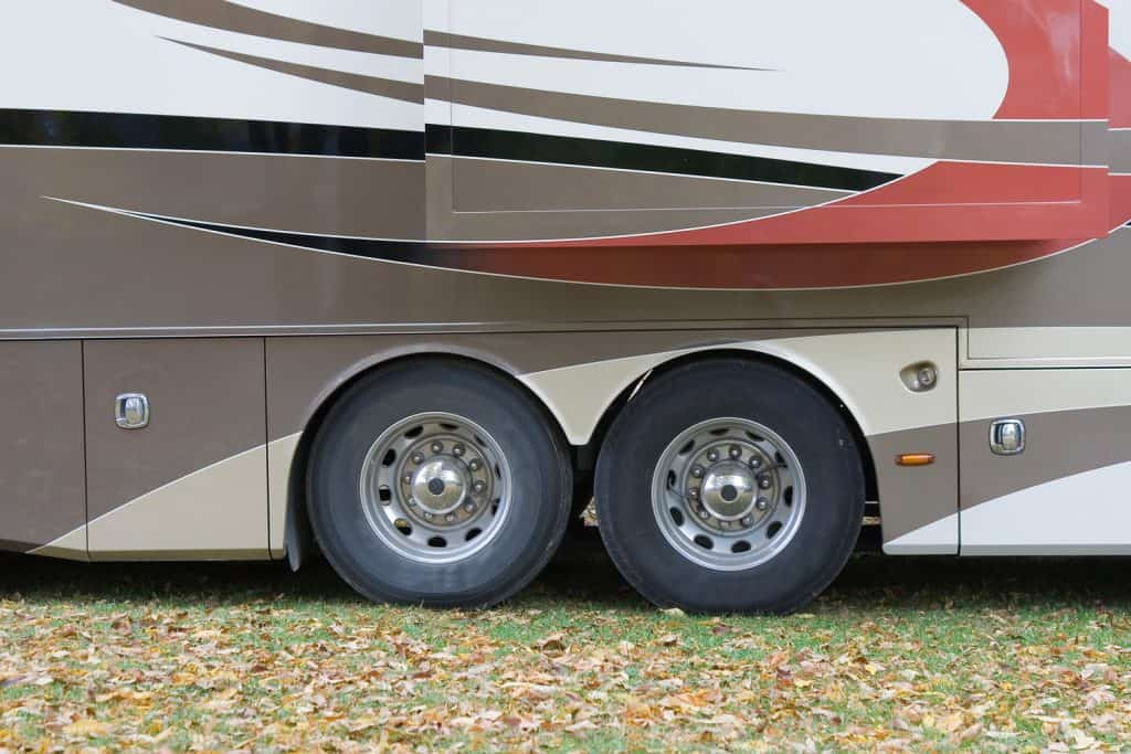 Motorhome parked in campground, RV wheels
