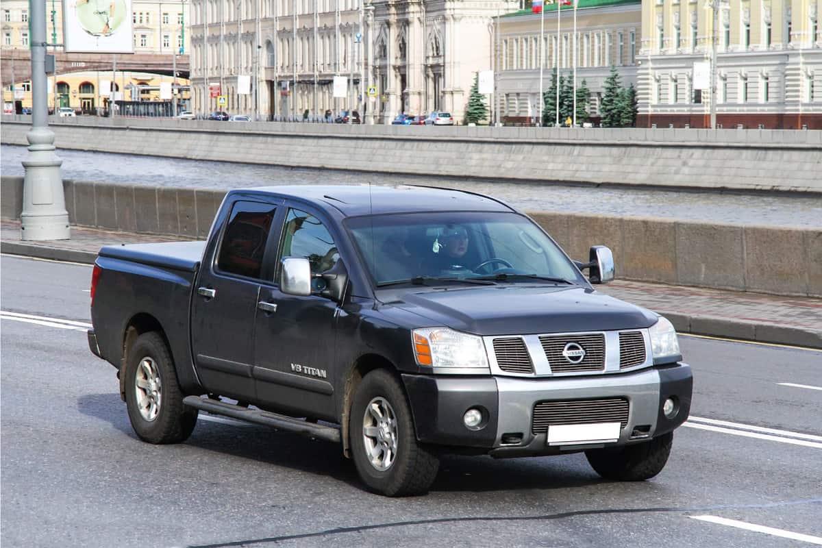 Pickup truck Nissan V8 Titan in the city street